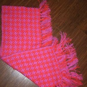 Pink and orange herringbone scarf with fringe